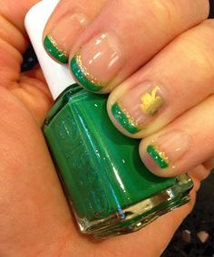 Subtler St. Patrick's Day nails with a gold four leaf clover at 20 Super Fun St. Patrick's Day Nail Designs