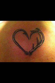 Deer antlers + fishing hook heart. Redneck love!!! I'm definitely getting this soon!!!!