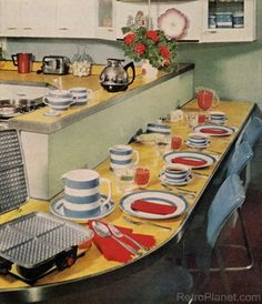 What an inviting unique, appealing wrap around 1950s kitchen table. #yellow #blue #red #counters #table #home #decor #vintage #retro #1950s #kitchen