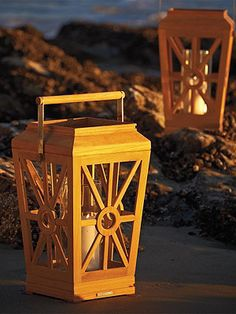 Coastal Teak Outdoor lanterns give your backyard a warm feeling.