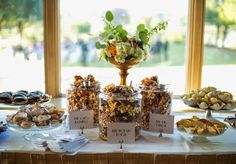 Fun popcorn and sweet treats bar! Popcorn by Brown Egg Bakery. Floral by Poppy Lane Design. Wedding by Gibson Events. Photo by Josh McCullock Photography. #wedding #popcorn #sweettreat #dessertbar