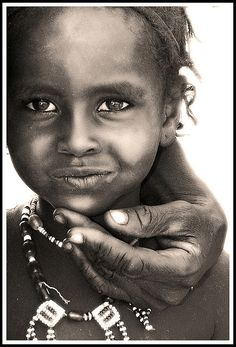 Africa | Afar kid with the hand of his proud father, Danakil desert, Ethiopia by Eric Lafforgue.