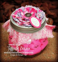 I like the idea of filling a mason jar with a treat and decorating it with flowers cut out with dies, etc.