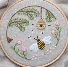 Little bee scene in a hoop.