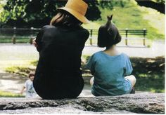 "Jackie sits with granddaughter Rose in Central Park, early 1990s.  Caroline's three children always referred to her as ""Grand Jackie."""