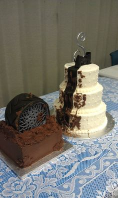 The grooms cake tire has splattered mud on to the wedding cake. The bride wanted something with a feminine and masculine feel and this is what she ordered! Great fun to make and they loved it!
