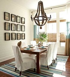 coastal dining room. I love the white parsons chairs and wood table.