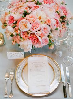 Lush arrangement consisting of a variety of Roses in shades of pink. #wedding #flowers