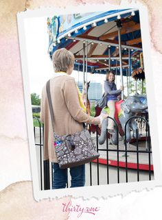 A fun mother/daughter moment shared with our Free To Be Carry-All in Brown Woodblock Floral!