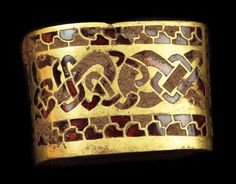 Paved with garnets, this gold sword-handle fitting was among many combat-related treasures--possibly spoils of war--in the largest known Anglo-Saxon gold hoard, announced September 24, 2009.