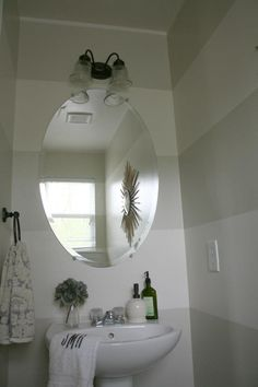 Striped bathroom main floor bath idea.  Benjamin Moore quiet moments and beach glass for a subtle tone on tone stripe.
