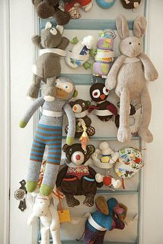 Shoe rack on door for stuffed animal storage