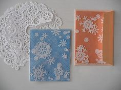 Clip your snowflakes (or Flowers) out of paper doilies