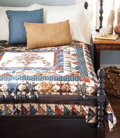"""This traditional quilt pattern from our July/Aug issue uses a center panel that is a reproduction of a""""calico"""" panel printed by textile printer John Hewson inthe late 1700s in Philadelphia. Designed and quilted by Liz Porter."""