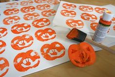 Jack-o-lantern stamping with apples