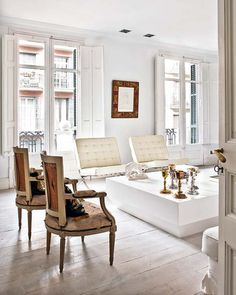 perfect mix of modern and traditional in a neutral palate! LOVE the barcelona chairs and the shutters