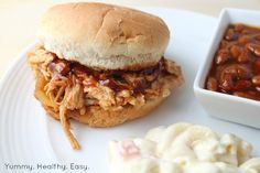 Easy and DELICIOUS Crock Pot BBQ Pulled Pork Sandwiches. Fork tender pork cooked right in the crock pot and using only 5 ingredients!