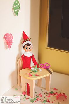 Elf on the Shelf makes paper snowflakes