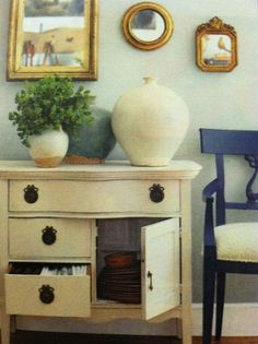 love the gold frames and blue chair
