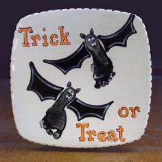 Painted Bats - Hand Prints onto Ceramics ... Would be cute on paper (as a craft), too :)