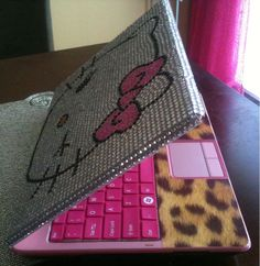 hello kitty computer with leopard print. PERFECTION!