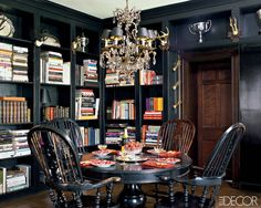 The library shelves are studded with antlers from European hunting lodges and trophies found at flea markets and on eBay. dining rooms, black walls, home libraries, black magic, elle decor, book, windsor chairs, badgley mischka, black rooms