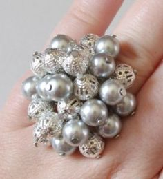 The holidays are the perfect time to bust out every bauble in your closet-- though perhaps not all of them at once. The Blingy Bobble Ring, in sleigh bell silver, is festive without being over-the-top.