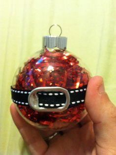 Santa Ornament. Red shredded foil giftbag grass (or red glitter paint, etc.), black ribbon, soda tab.