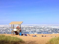 People laying on the beach in Marquette. Oh yeah, and a lake full of ice practically in June.