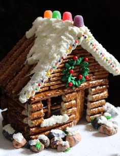 Pretzel log cabin instead of the traditional gingerbread... very simple and cute! pretzel log, decor pretzel, tradit gingerbread, small log cabin decor, decorated log cabins, decorate a log cabin, pretzel cabin, gingerbread houses, small cabin christmas decor