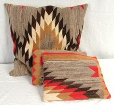 Set of throw pillows created with Navajo rug fragments. Rug c.1930\'s. Good condition, some loosening at the seams.