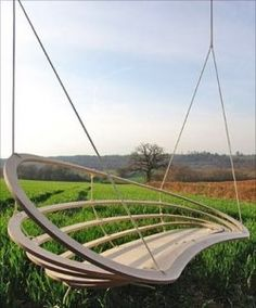 interesting shape and design for this outdoor swing...