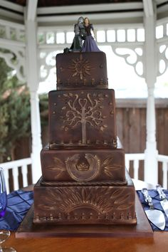 Lord of the Rings wedding cake: Eowyn and Faramir on Rohan/Gondor cake, by One Sweet Slice in South Jordan, Utah http://www.onesweetslice.com (marbled chocolate and yellow cake with strawberry filling, buttercream frosting, and chocolate fondant, and yes, it was delicious)(post by A.Sedivy)