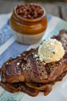 Grilled and Blue Cheese Buttered Steak with Bourbon Caramelized Onions