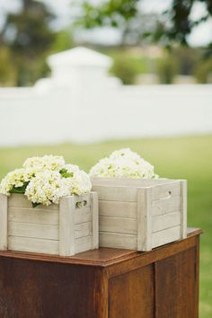 I love the white hydrangea's in the white boxes. very pretty
