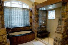 Rustic Master bath - stone walled steam shower...