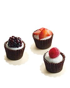 These bite-size desserts satisfy sugar cravings without any of the heaviness normally associated with chocolate. To make the shells, paint melted chocolate inside paper candy cups. Once set, peel the paper away. Spoon or pipe a mixture of whipped cream and creme fraiche into each cup, top with a berry of your choice, and serve.    Sounds yummy :)