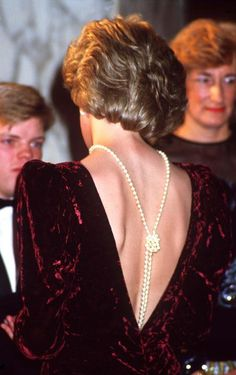 Back To The Future: Princess Diana (1961 - 1997) at the premiere of 'Back To The Future', London, December 1985.She is wearing a plum crushed-velvet evening gown with a low backline and pearls. (Photo by Terry Fincher/Princess Diana Archive/Getty Images) icon, december, london, pearl jewelry, pearl necklaces, peopl princess, princess diana, evenings, diana jewelri