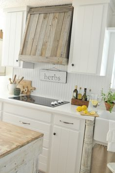 Combine white-painted countertops with contrasting wood for a fabulous farmhouse kitchen.