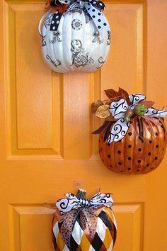 Cut dollar store pumpkins in half, decorate & hang