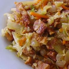 Fried Cabbage with Bacon, Onion, and Garlic.  Delicious.  I used a bag of cole slaw mix instead...just a shortcut. ****
