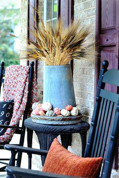 wheat and pumpkins in vintage galvanized chicken feeder