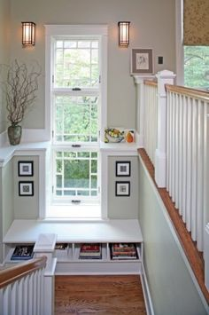 shelf and pictures in stairwell, giant window