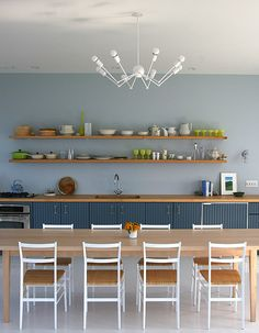 Great modern dining room space with blue hues.