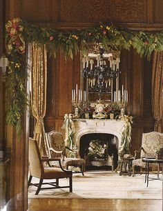 Beautiful garland and mantle decorations in a gorgeous room.