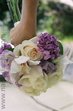 Doing a wedding with purple and champagne theme.  Love this bouquet!