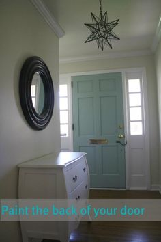I really like this idea. Paint the back of the front door to bring color to the space.