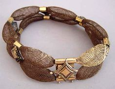 Victorian table worked hair bracelet with gold stations and clasp,  amazingly delicately worked, circa 1870.