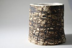 Hand built earthenware vessel with unique texture and aged look. Good conversation piece!