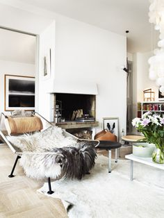 love the fur - textures warm up white interiors